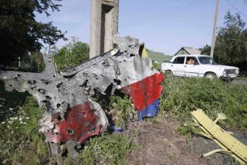 Torn from MH-17 Cockpit at cruising altitude. Note evidence of high-callibre bullet holes.
